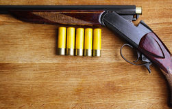 Shotgun with shells Stock Photos