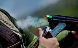 Shotgun throwing its shell Royalty Free Stock Photo