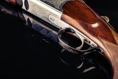 Shotgun trigger on black Stock Images