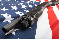 Shotgun on USA flag as a symbol of second amendment Stock Image