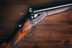 Shotgun  on wooden background Royalty Free Stock Photos
