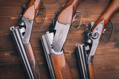 Shotgun  on wooden background Stock Photo