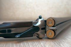 Shotgun. A wooden retro shotgun with shotgun shells Stock Image