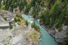 The shotover river cutting through a rocky gorge. In the  south island of New Zealand Royalty Free Stock Image