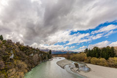 Shotover RIver, New Zealand and cloudy background Stock Images