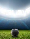 Shotput Ball In Generic Floodlit Stadium Royalty Free Stock Image