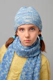 In between the shots ... Pensive girl with the braids dressed in knitted pullover, scarf and hat stock photos