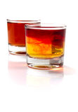 Shots. Two colorful, strong designer shots containing whiskey and several types of liquor Stock Photography