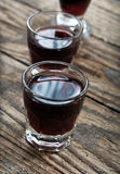 Shots of alcohol. On wooden table Royalty Free Stock Photography