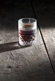 Shots of alcohol on wooden table. Close up Stock Photo