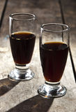 Shots of alcohol on wooden table. Close up Royalty Free Stock Image