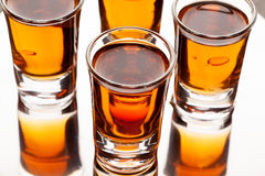 Shots of alcoholic drinks on the reflecting surface Stock Photo