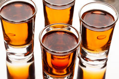 Shots of alcoholic drinks on the reflecting surface Royalty Free Stock Photos