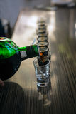 Shots of booze ready to party Stock Photography