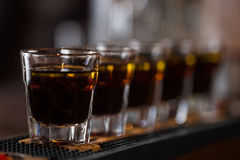Shots cocktail bar. Whisky shot drinks in row. Alcoholic shots in nightclub Royalty Free Stock Photography