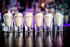 Shots coktails on the bar. Royalty Free Stock Photography
