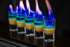 Shots in nightclub. Barman make alcoholic shots in nightclub Stock Photography