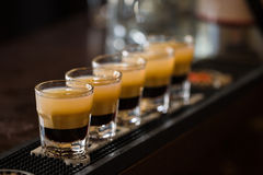 Shots with rum and liquor in cocktail club. Barman make alcoholic shots with rum and liquor in nightclub Stock Photo
