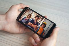 Shots from the tv series Stranger Things season 3. On Netflix streaming platform on the phone in the man`s hands. Editorial illustrative photo of popular series stock photos