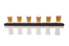Shots on wooden tray. Isolated on white background Royalty Free Stock Photos