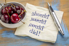 Should, would, could, did!. A motivational concept - handwriting on a napkin with a bowl of cherries Royalty Free Stock Photography