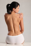Shoulder back pain for semi naked young woman Royalty Free Stock Photography