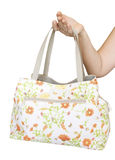 Shoulder Bag in the hand. Pink shoulder Bag in the woman hand isolated on a white background Stock Image