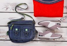 Shoulder bag, sneakers and jumper Royalty Free Stock Image
