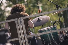 Shoulder drummer playing at a rock concert.  royalty free stock image