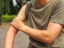 Shoulder injury in humans .shoulder pain,joint pains people medical, mono tone highlight at shoulder.  stock photography