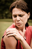 Shoulder injury - sportswoman in pain Stock Photos