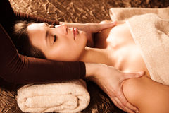 Shoulder massage. Woman enjoy in shoulder massage in spa salon Stock Image