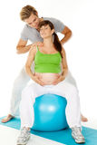 Shoulder massage pregnant woman Stock Photos