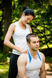 Shoulder massage after sport training Stock Photography