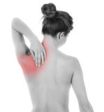 Shoulder and nape pain. Woman having pain on her back, isolated on white royalty free stock image