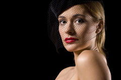 Shoulder net. Attractive blond woman with red lips and net over her face looking at camera Stock Photos