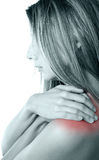 Shoulder pain. Woman pressing her hands against a painful shoulder royalty free stock photos