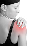 Shoulder Pain. Young woman with pain in her shoulder Stock Image