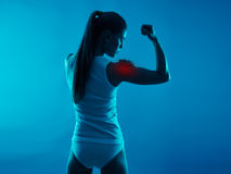 Shoulder pain. Or inflammation indicated with red spot on young woman body. Rheumatism treatment concept stock images