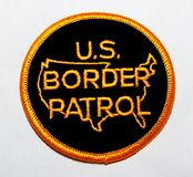 The shoulder patch of the US Border Patrol. USA on a white background stock photography