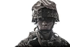 Equipped army soldier with dirty face studio shot stock images