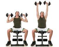 Shoulder Press. Dumbbell shoulder press exercise. Studio shot over white stock photo