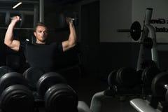 Shoulder Press Workout. Young Men Doing Shoulder Press Whit Dumbbells royalty free stock photography
