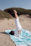 Shoulder stand at the beach Stock Image