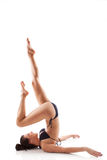 Shoulder stand. Beautiful girl in bikini doing shoulder stand. Caucasian woman doing yoga. Sarvangasana asana Stock Photo
