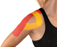 Shoulder therapy with tex tape Royalty Free Stock Images