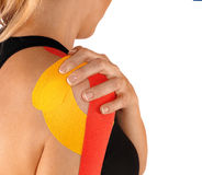 Shoulder therapy with tex tape Stock Photography