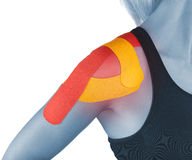 Shoulder therapy with tex tape Stock Images