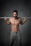 Shoulder working for a cross fitter. Dark background Royalty Free Stock Image