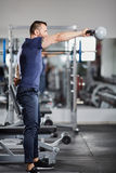 Shoulder workout with kettle Royalty Free Stock Photography
